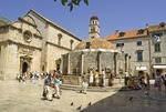 Dubrovnik Old Town's Big Onofrio's Fountain with Church of St. Saviour  and Franciscan Monastery museum at left