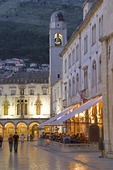 Dubrovnik Old Town cobble stone Pred Dvorom  street with Bell Tower and City Hall in evening