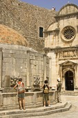 Dubrovnik Old Town's Big Onofrio's Fountain and Church of St. Saviour next to steps to entrance to the City Walls