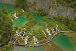 Plitvice Lakes National Park, waterfalls in canyon at northern lower end of park with visitors boardwalk