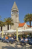 Trogir sidewalk cafe at St Dominic's Church on waterfront