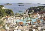 Amfora Hvar Grand Beach Resort hotel pool area overlooking offshore islands in Adriatic