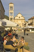 Hvar main town square outdoor cafes with St Stephens Cathedral, on island of Hvar in Adriatic