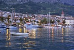 Makarska harbor and waterfront at twilight along Adriatic coast