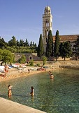 Hvar beach next to Franciscan Mmonastery, on island of Hvar in Adriatic