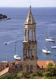 Hvar's medieval Venetian church bell tower overlooking harbor, on island of Hvar in Adriatic