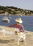 Hvar harbor waterfront bench, on island of Hvar in Adriatic