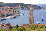 Hvar's medieval Venetian church bell tower overlooking town's harbour and waterfront, on island of Hvar in Adriatic