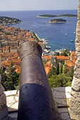 Hvar 's Spanjola fortress cannon, overlooking town and harbor on island of Hvar