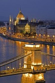 Budapest's Szechenyi Chain Bridge over Danube with Parliament in background on Pest side
