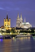 Great St Martin's Church and Cologne Cathedral on Rhine River at night