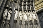 Cologne Cathedral entrance with sculptures of saints