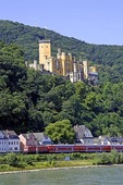 Stolzenfels Castle on Rhine River near Koblenz with intercity passenger train