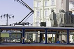Bratislava bus in Ludovit Stur Square passing Memorial for National Heroes