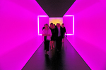 Houston Museum of Fine Arts, patrons in colorfully lighted corridor installation by James Turrell