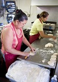 Houston's East End neighborhood restaurant Villa Arcos Tacos, Hispanic women in kitchen