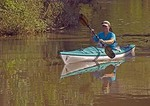 Houston's Buffalo Bayou waterway with recreational kayaker