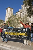 Hispanics protesting building of wall on Mexican border with demonstration in downtown San Antonio, Texas