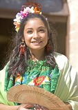 San Antonio Founder's Day, young Hispanic woman in traditional dress in San Fernando Cathedral Plaza