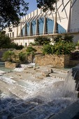 San Antonio's Henry B. Gonzalez Convention Center with HemisFair Plaza water fall fountain in foreground