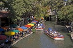 San Antonio Riverwalk river side Casa Rio restaurant with Rio San Antonio Cruises dining cruise and tour boat on San Antonio River