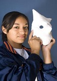 San Antonio's Say Si Art Studio Youth Arts Program student with mask for Day of the Dead (Dia de los Muertos) Festival