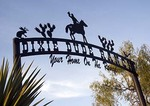 Texas Hill Country, Dixie Dude Ranch, gate sign at entrance
