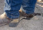 Texas Hill Country, Dixie Dude Ranch, Christian ranch hand's cowboy boots and spurs