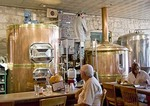 Texas Hill Country, Fredericksburg Brewing Company brew master with brewery tanks in restaurant
