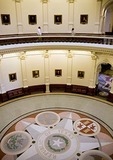 Texas State Capitol rotunda with portraits of governors in Austin