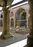 Erzurum's Cifte Medrese, courtyard with workmen restoring garden, Seljuk architecture built in 1236
