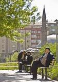 Erzurum's Yakutiye Medrese garden, elderly Turkish men at leisure