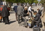 Erzurum shoe shine stand on street near Yakutiye Medrese