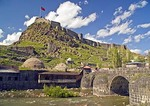 Kars Kalesi (Castle or Kale), Armenian fortress and Ottoman citadel, with volcanic stone bridge and old bath houses along Kars River, on hilltop overlooking city of Kars