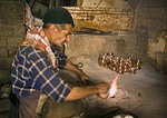 Mardin bazaar coppersmith forging copper pots