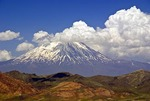 Mt. Ararat, snow-capped dormant volcano and site of Noah Biblical story, partially obscured by clouds