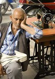 Sanliurfa (Urfa) man midday napping at his sewing machine in market