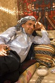 Harran Culture House with Kurdish Turk man drinking tea