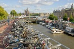 Amsterdam multistory bicycle parking lot along canal near Centraal Station
