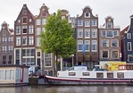 "Amsterdam's ""Swaying Sisters"", leaning buildings along Amstel River rumored to be drunken includes Hotel Amstel Zicht"