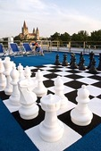Danube River cruise ship, recreation deck with oversized chess set, docked at Vienna