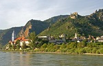 Durnstein village on bank of Danube River with ruin above of Kuenringer Castle where Richard the Lionheart once held as prisoner