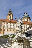 Melk Abbey, with religious sculpture in town below, in scenic Wachau Valley