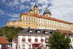Melk Abbey, looming over Hotel Stadt Melk in town below, in scenic Wachau Valley along Danube River