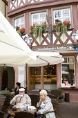 Wertheim cafe with tourist customers outside enjoying coffee and pastries