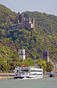 Katz Castle (Burg Katz) overlooking town of St. Goarshausen and Rhine River with cruise ship