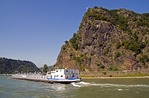 Barge rounding Lorelei Rock bend in Rhine River