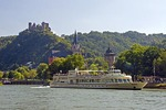 Oberwesel on Rhine River with river cruise ship, Schonburg Castle ruins on hill above town