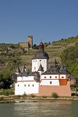 Pfalz Fortress on Rhine River at Kaub with vineyards and Gutenfels Castle in background