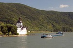 Pfalz Fortress on Rhine River at Kaub with barge passing down river